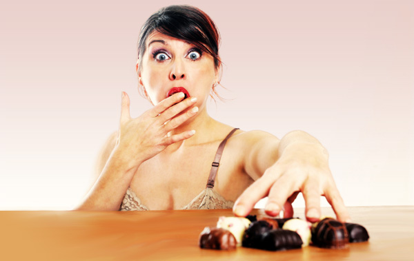frustated-woman-eating-chocolate